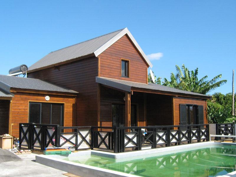 Concept habitat bois industrie fabrication de maison for Constructeur de maison en bois ile de la reunion